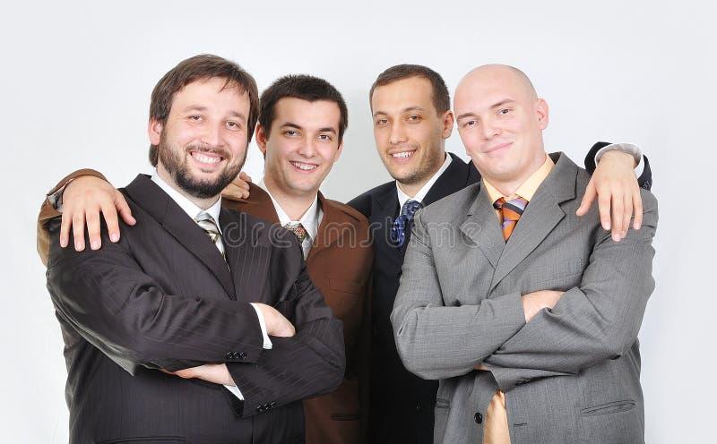 Grupo de hombres de negocios jovenes junto fotografía de archivo libre de regalías