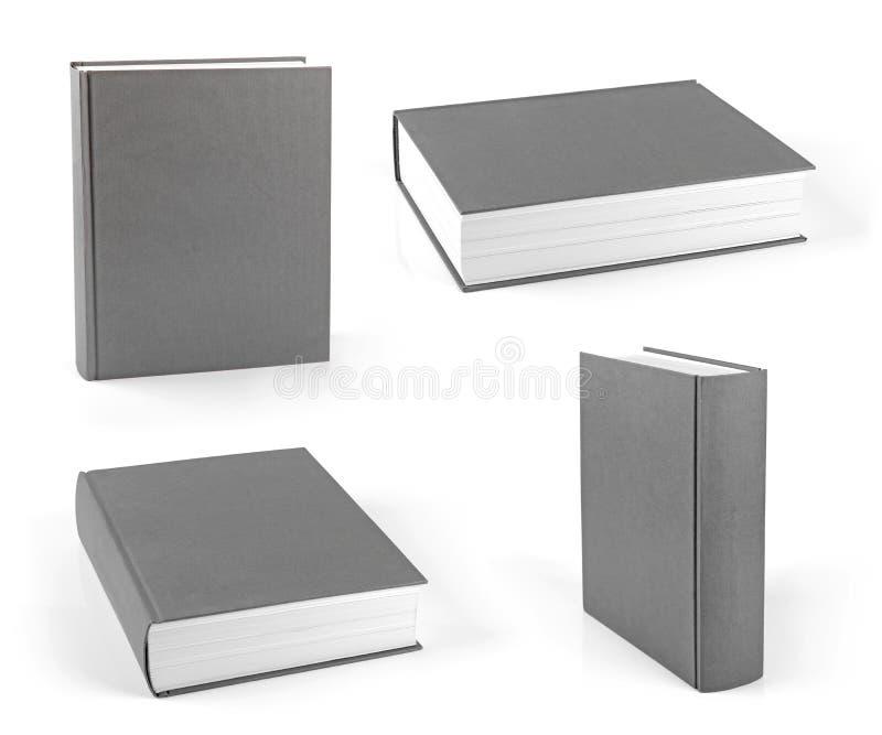 Grupo de livros de capa dura cinzentos vazios isolados no branco fotos de stock