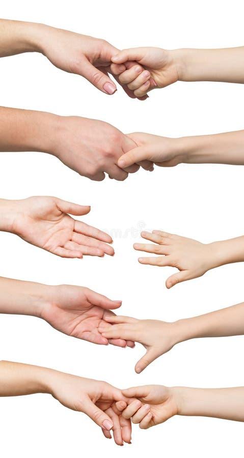 Grupo de mão da criança da terra arrendada da mãe isolada no fundo branco fotografia de stock royalty free