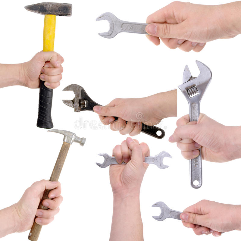 Grupo de mãos que guardam ferramentas de funcionamento fotografia de stock