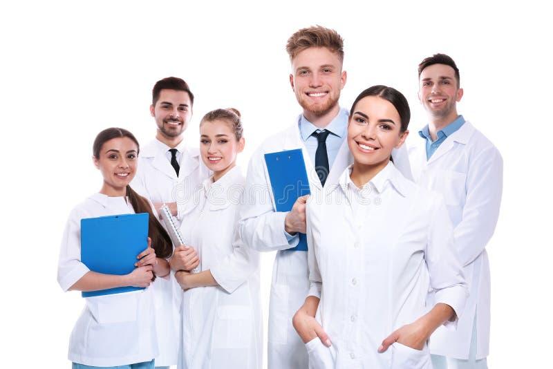 Grupo de médicos aislados Concepto de la unidad fotos de archivo