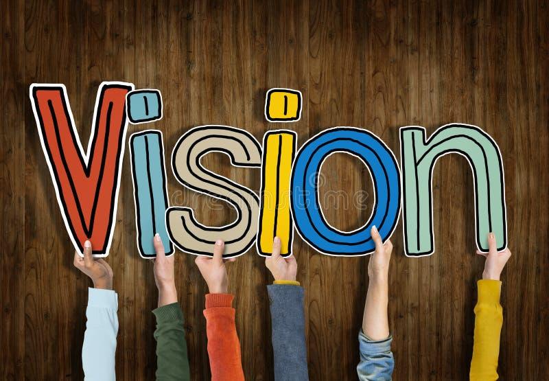 Grupo de manos que llevan a cabo la letra Vision imagen de archivo