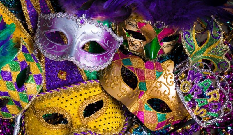 Grupo de Mardi Gras Mask en fondo oscuro con las gotas foto de archivo
