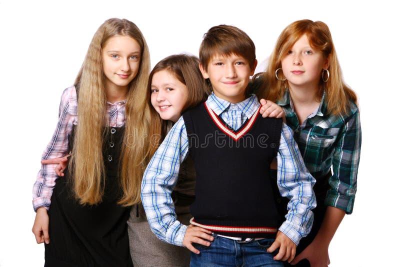 Grupo de miúdos bonitos e felizes fotos de stock
