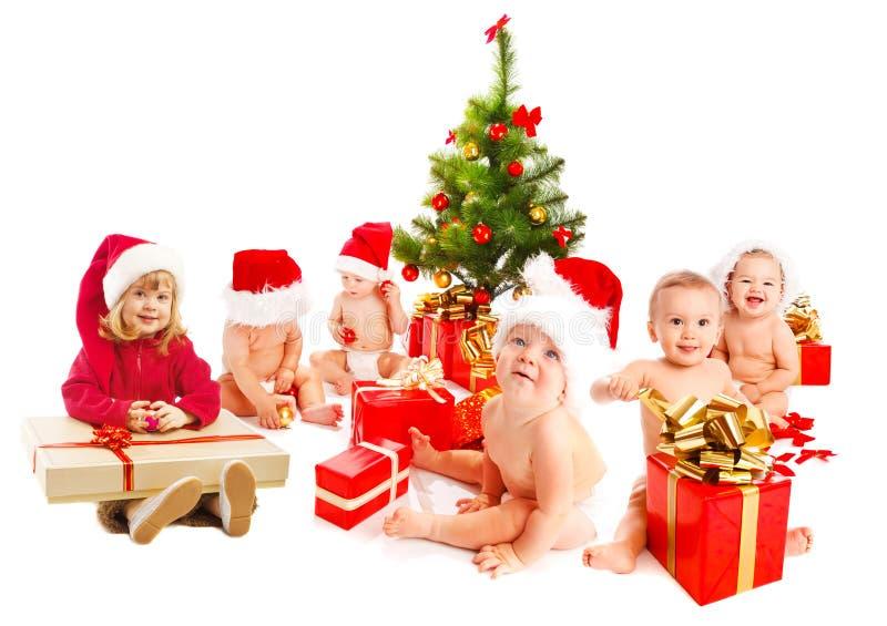 Grupo de miúdos do Natal imagem de stock