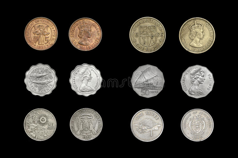 Grupo de moedas insulares dos países foto de stock