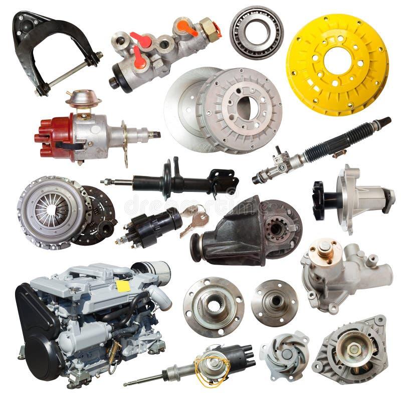 Grupo de motor e de partes automotivos sobre o branco fotografia de stock