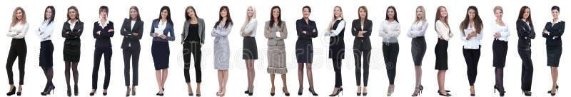 Grupo de mulher de negócios nova bem sucedida que está em seguido imagem de stock