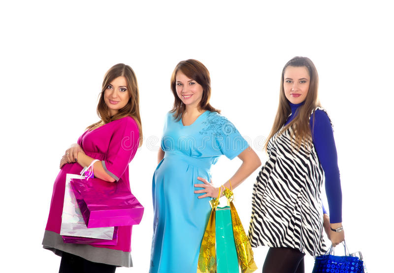 Grupo de mulheres gravidas com sacos de compra foto de stock