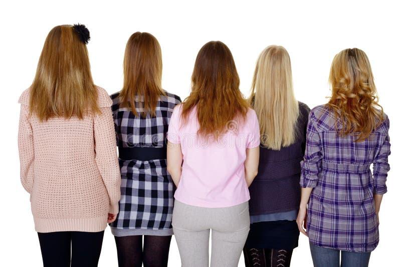 Grupo de mulheres novas - vista traseira isolada no branco fotografia de stock