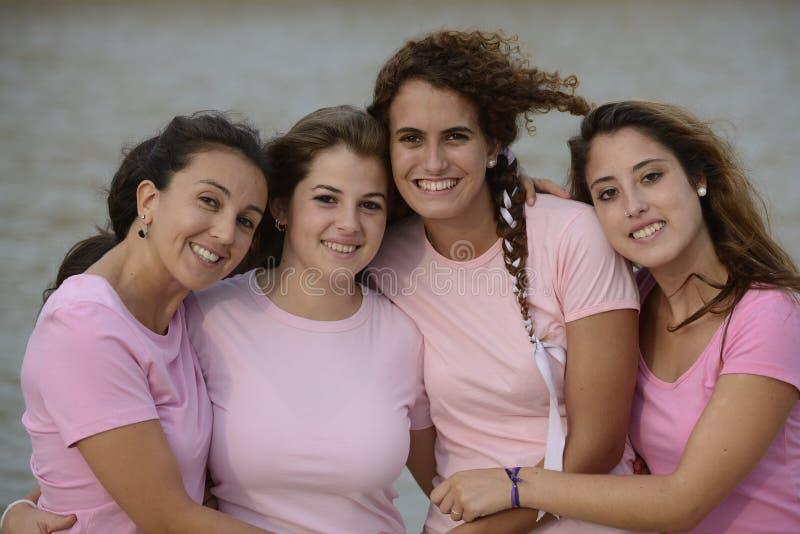 Grupo de mulheres que desgastam a cor-de-rosa imagens de stock royalty free
