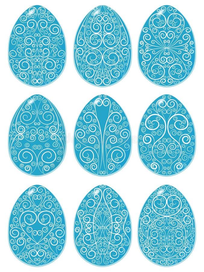 Grupo de ovos da páscoa azuis com teste padrão branco foto de stock