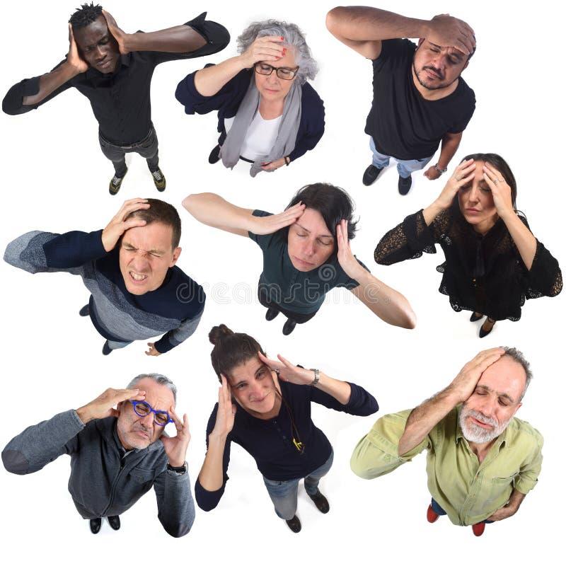 Grupo de personas con dolor de cabeza en blanco fotografía de archivo libre de regalías