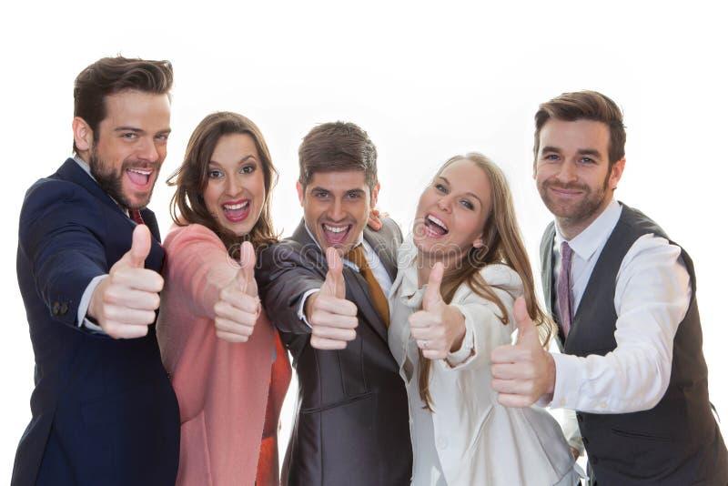 Grupo de pessoas com polegares acima imagens de stock royalty free