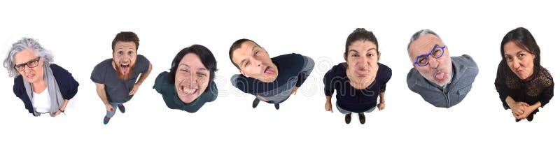 Grupo de pessoas fazendo rostos imagens de stock