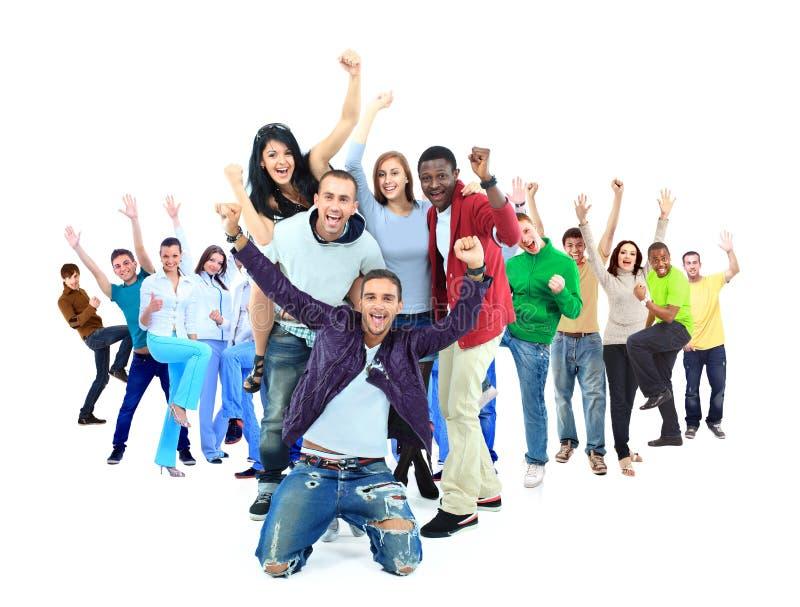 Grupo de pessoas feliz com braços acima - isolado fotografia de stock royalty free
