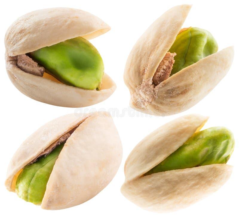 Grupo de pistaches em um fundo branco fotos de stock
