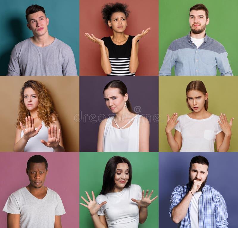 Grupo de povos diversos confusos em fundos do estúdio fotografia de stock