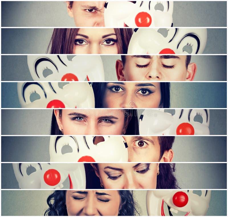 Grupo de povos irritados tristes que escondem emoções reais atrás da máscara do palhaço foto de stock royalty free