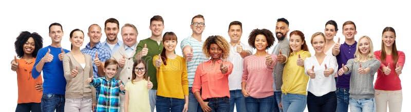 Grupo de povos de sorriso que mostram os polegares acima foto de stock