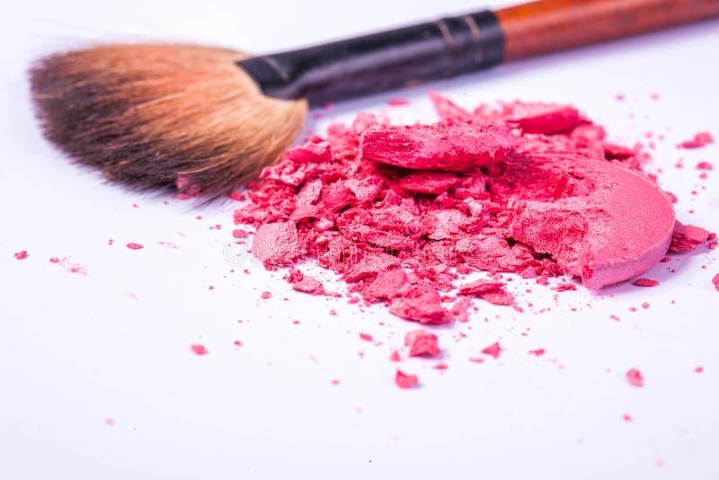 Grupo de productos de maquillaje aislados en blanco imagenes de archivo