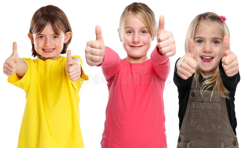 Grupo de pulgares que ganan sonrientes del éxito joven de las niñas de los niños de los niños encima del positivo aislado en blan foto de archivo libre de regalías
