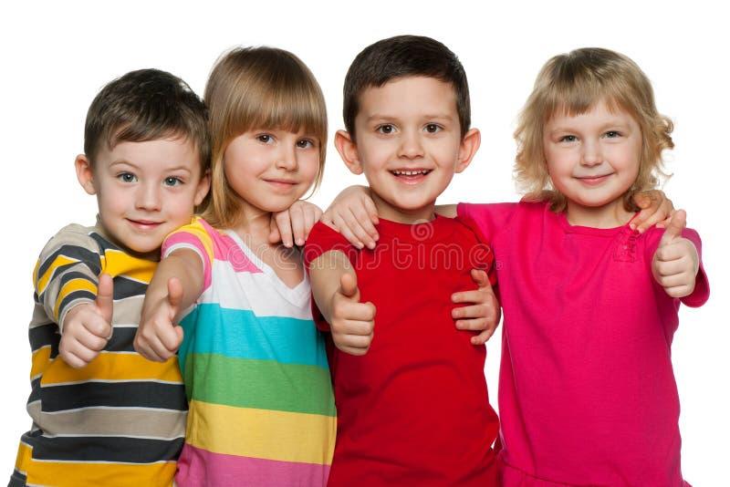 Grupo de quatro crianças fotografia de stock