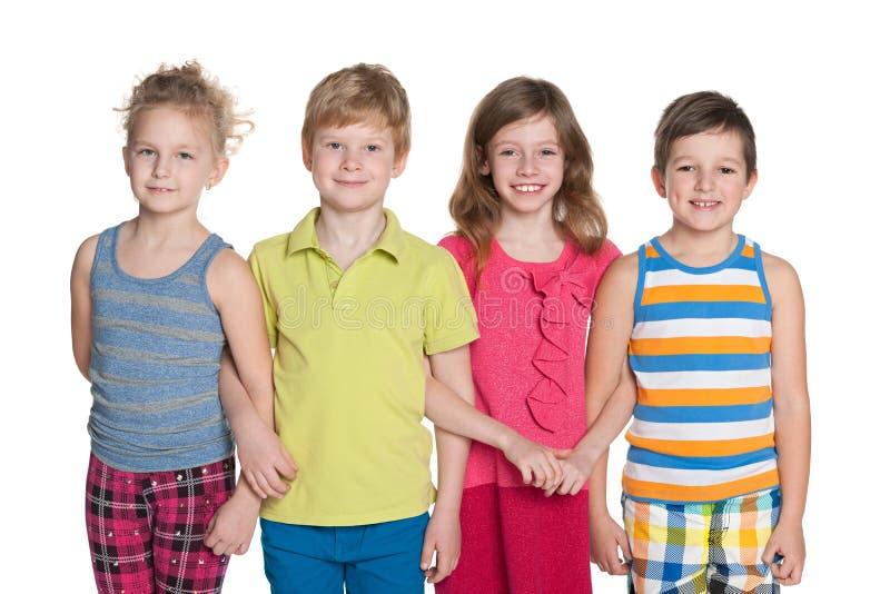 Grupo de quatro crianças imagens de stock royalty free