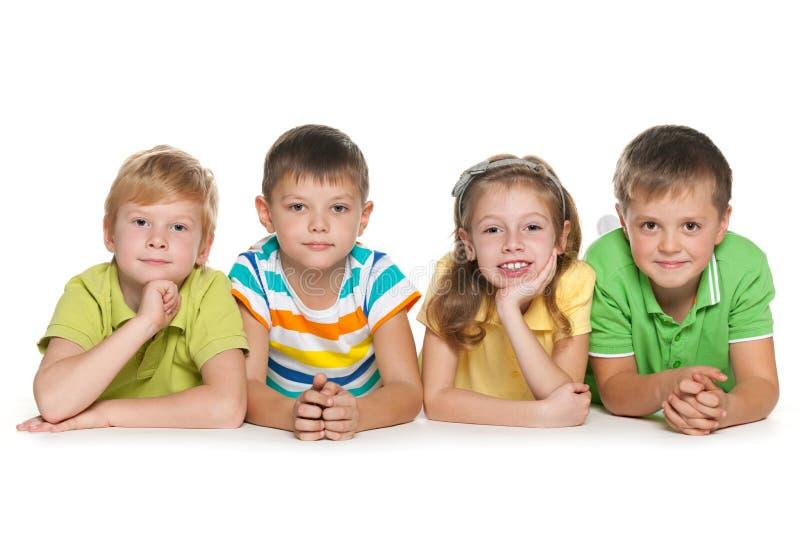 Grupo de quatro crianças alegres fotografia de stock royalty free