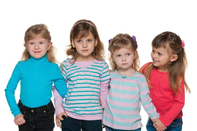 Grupo de quatro meninas pequenas imagens de stock royalty free