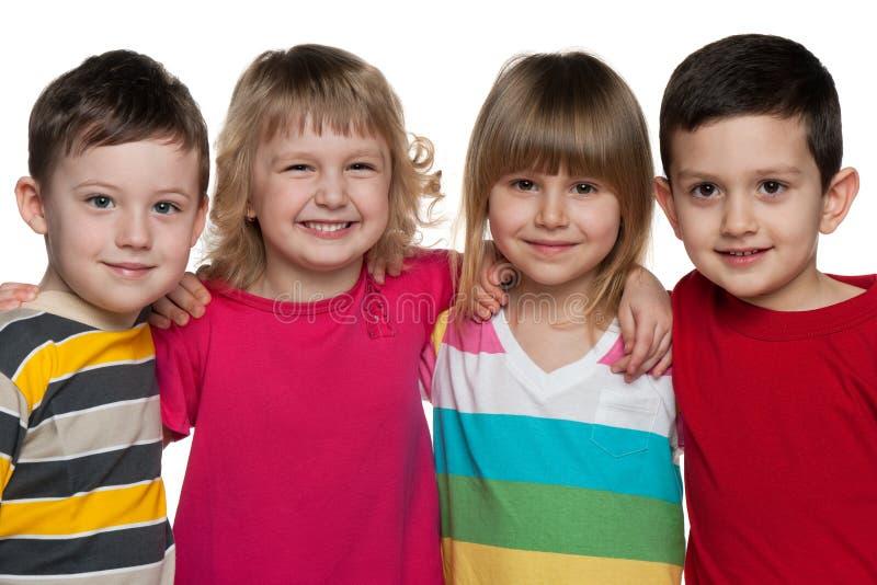 Grupo de quatro miúdos foto de stock