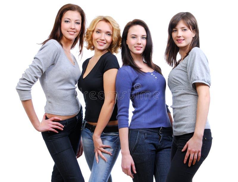 Grupo de quatro mulheres de sorriso felizes imagem de stock royalty free