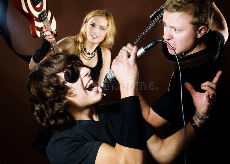 Grupo de rock no estúdio fotos de stock royalty free