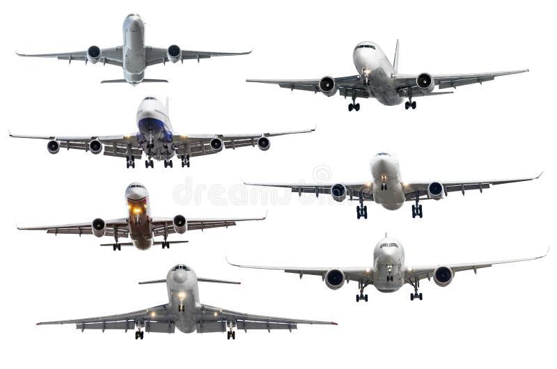 Grupo de sete aviões isolados do fundo imagem de stock royalty free