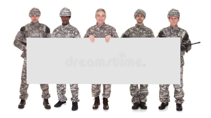 Grupo de soldado With Placard imágenes de archivo libres de regalías