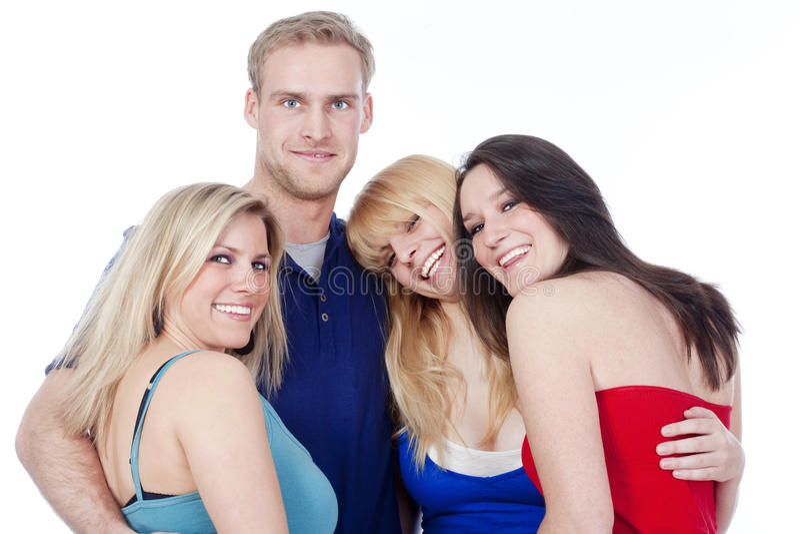 Grupo de sonrisa de cuatro amigos foto de archivo libre de regalías