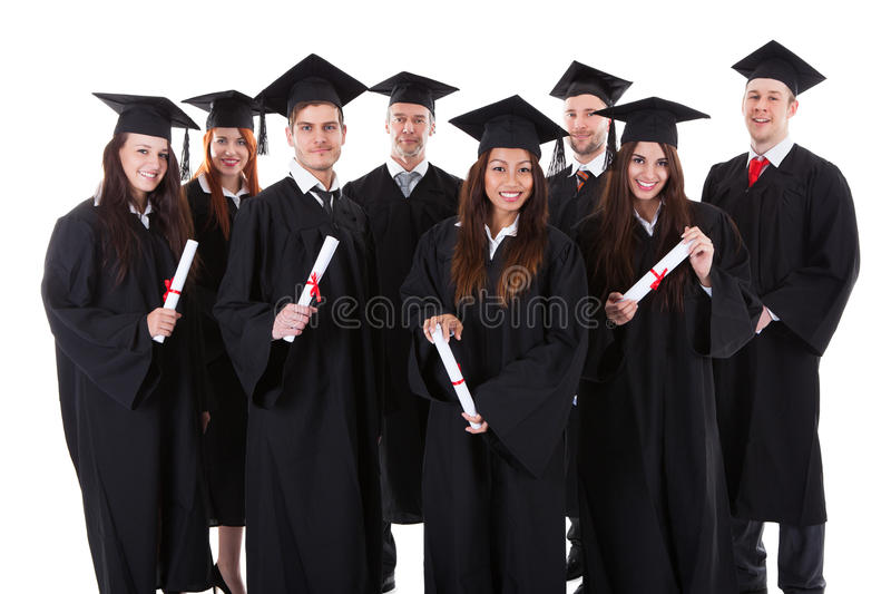 Grupo de sorriso feliz de graduados multi-étnicos imagens de stock royalty free