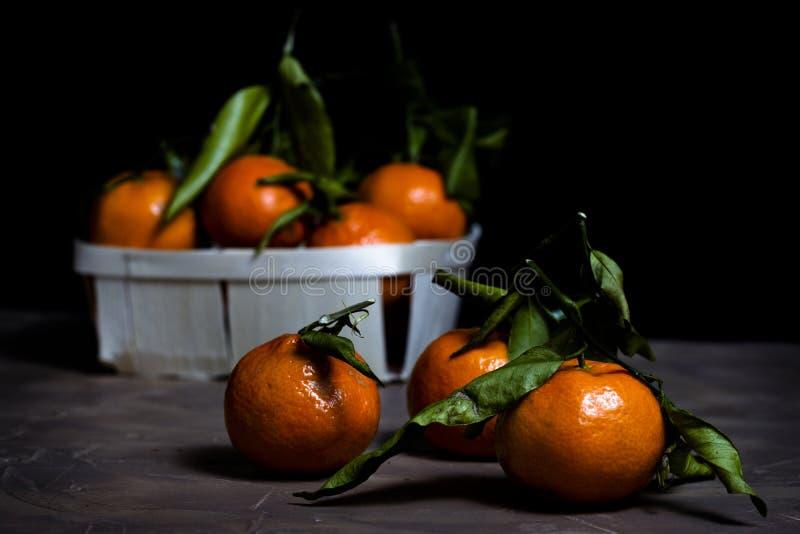 Grupo de tangerinas com folha verde imagem de stock