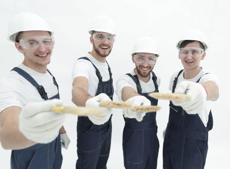 Grupo de trabalhadores da construção Isolado no branco fotos de stock