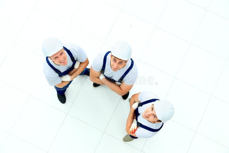 Grupo de trabalhadores industriais profissionais imagem de stock