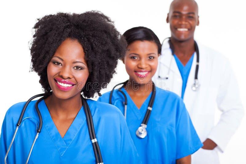 Trabalhadores pretos dos cuidados médicos imagens de stock
