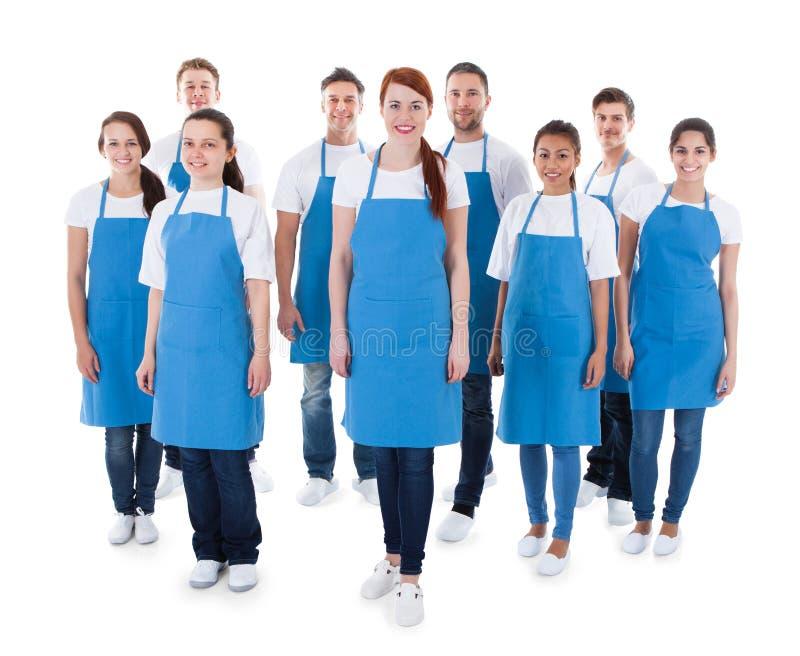 Grupo diverso de limpiadores profesionales imagenes de archivo