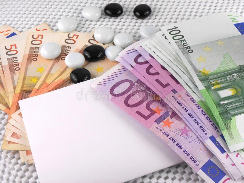 Grupo do dinheiro do Euro, papel vazio branco e pedras imagens de stock