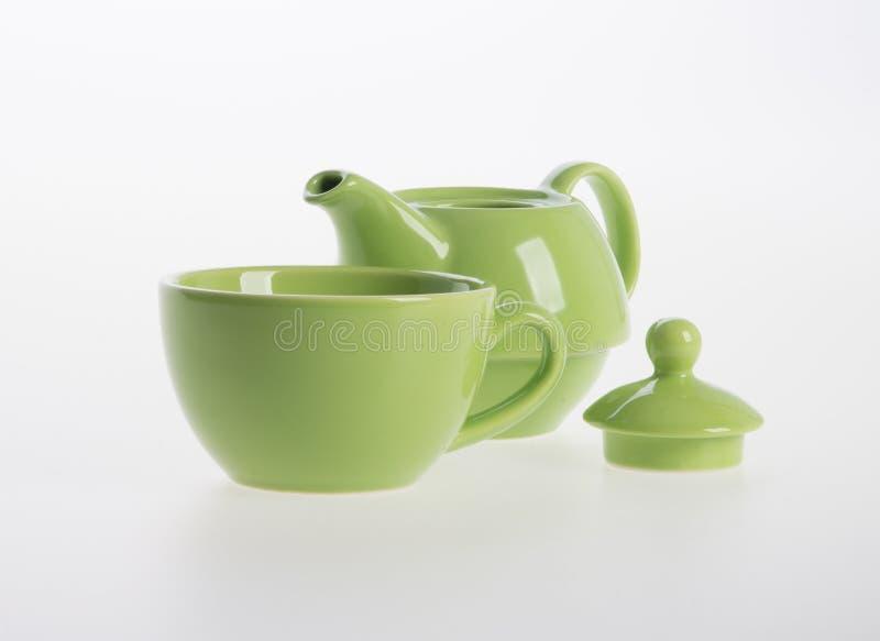 Grupo do potenciômetro do chá ou de chá da porcelana potenciômetro e copo no fundo foto de stock royalty free
