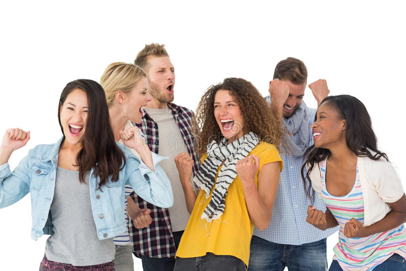 Grupo feliz de animar joven de los amigos imagen de archivo