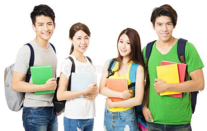 Grupo feliz de los estudiantes universitarios en blanco fotos de archivo