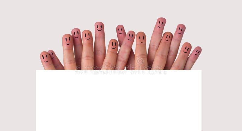 Grupo feliz de smiley del dedo fotografía de archivo