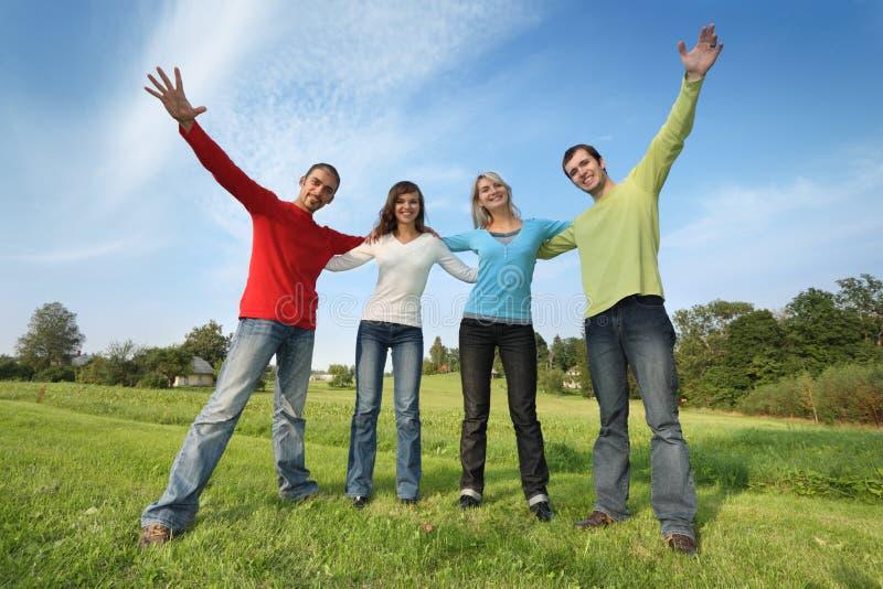 Grupo feliz dos amigos fotos de stock