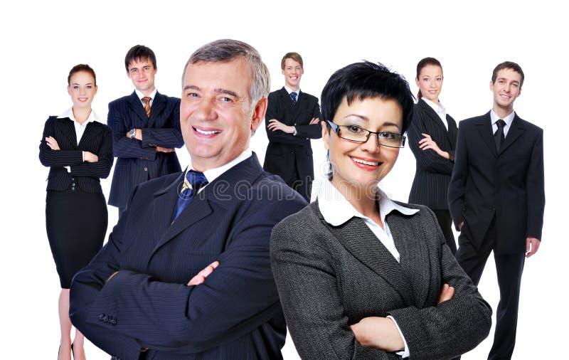 Grupo grande de empresarios acertados imagen de archivo