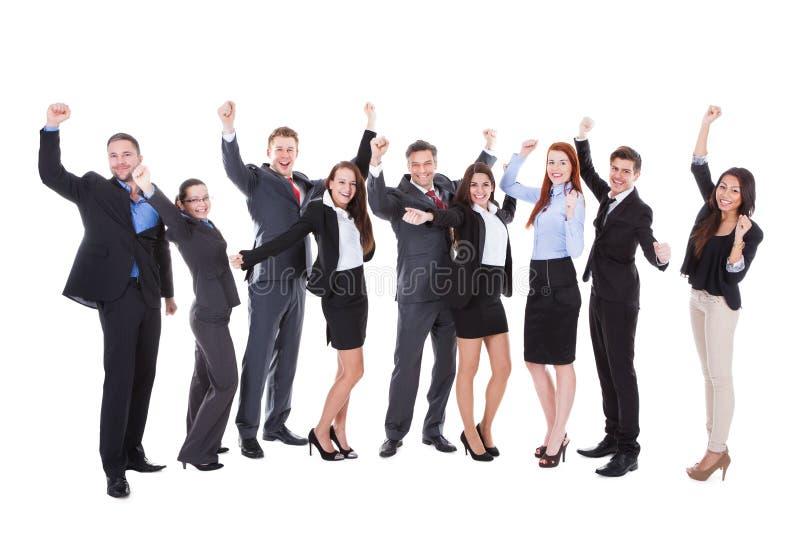 Grupo grande de hombres de negocios emocionados imagen de archivo